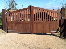 <h5>Gate Automation - 5</h5><p>Wooden automatic powered gates featuring curved head with open spindles, set on oak posts</p>