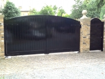 <h5>Gate Automation - 7</h5><p>Bow-top double powered gates finished in black with door entry system</p>