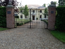 <h5>Bespoke Wrought Iron Gates with Brick Pillars</h5><p>Bespoke Wrought Iron Gates with Brick Pillars </p>